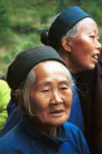 Jpeg 23K Close up of two Lao Han women in the Black Miao village of Dai Lo, Shi Zi township, Ping Ba county 15km east of the Puding county border in Guizhou province, South West China 0010z29A.jpg