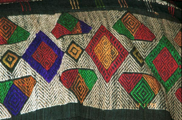 Detail of an embroidered hem of an old Southern White Thai sarong collected in Ban Lac village in the Mai Chau district, Hoa Binh (Ha So'n Binh) Province, Vietnam 9511A34E